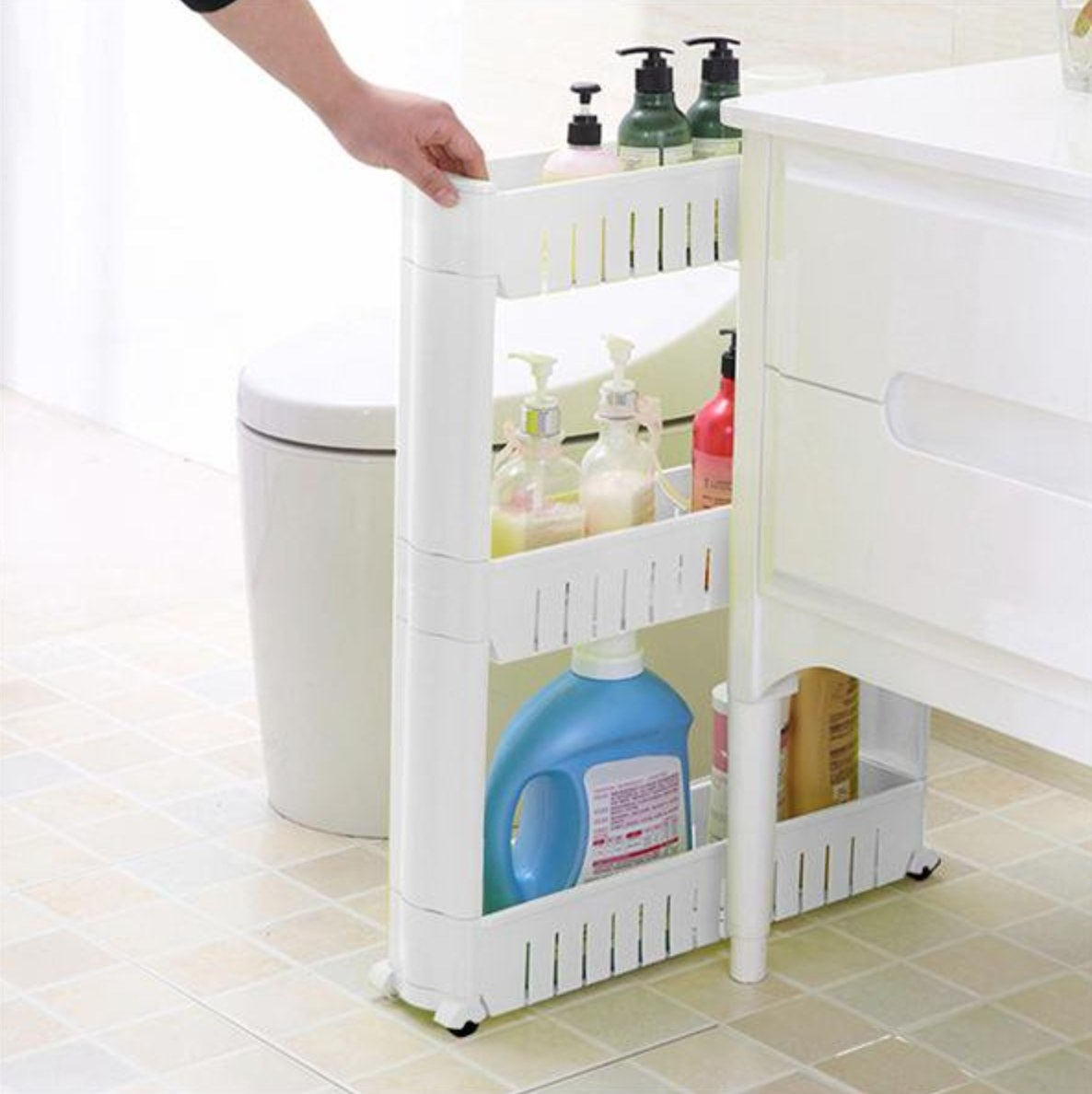 The white organizer being used as a caddy for bathroom productrs