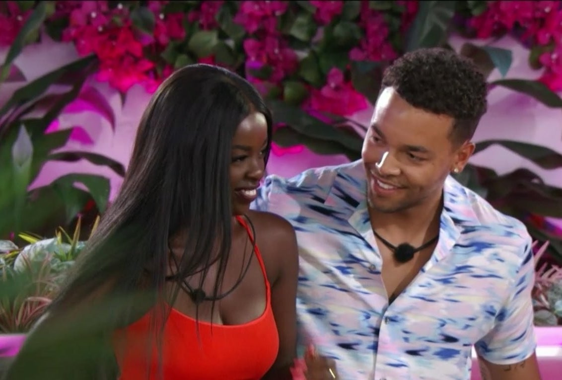 """""""Love Island"""" star Caleb smiling at Justine"""