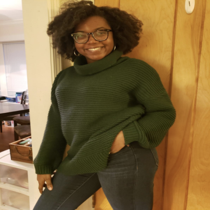 another reviewer in the turtleneck in olive green