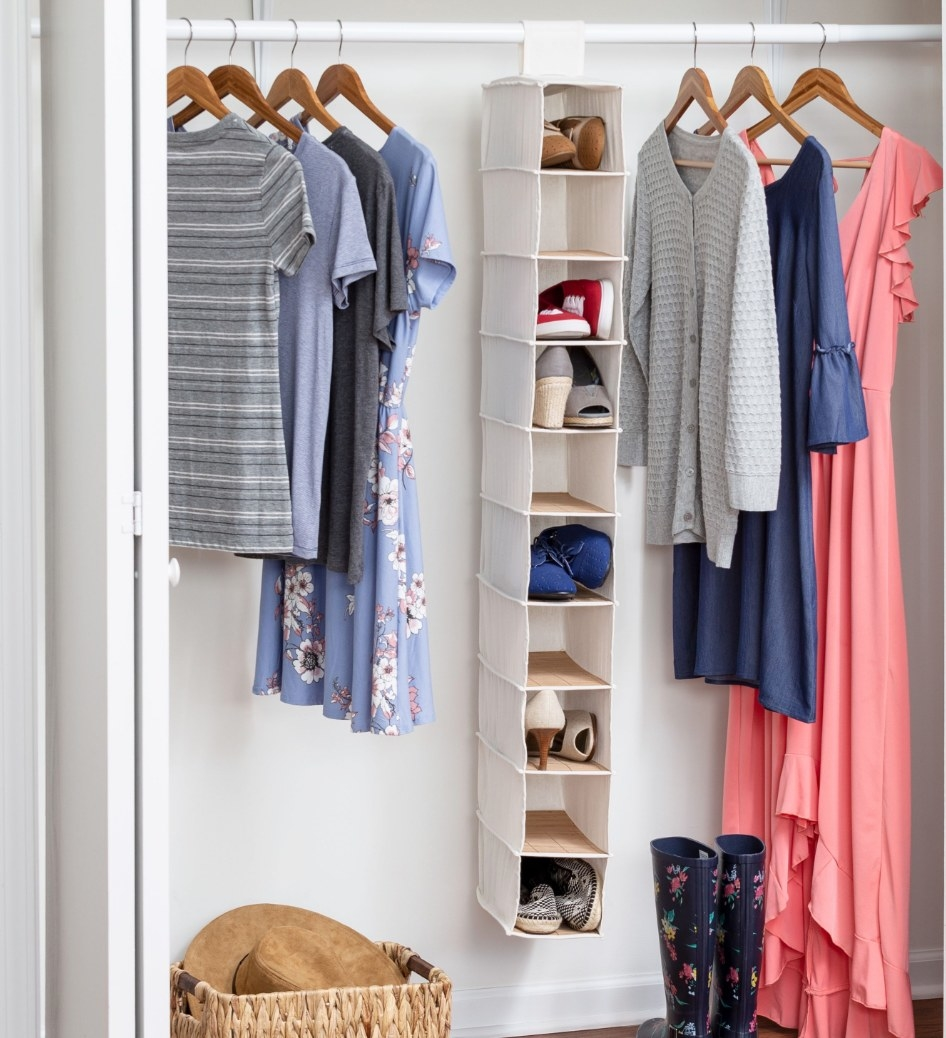 The white organizer hanging in a closet, holding shoes