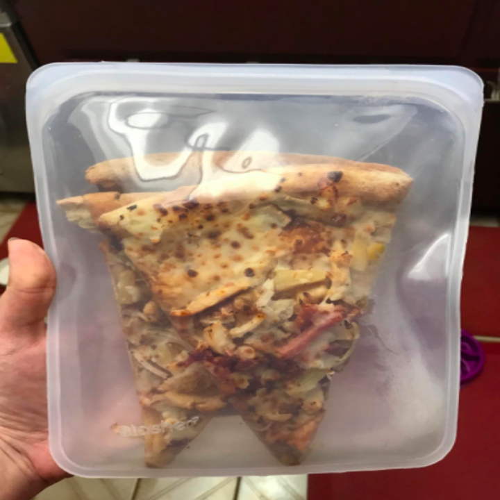 a couple slices of pizza in a clear half gallon version