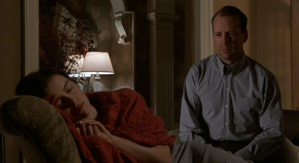 Malcolm looks at Anna as she sleeps