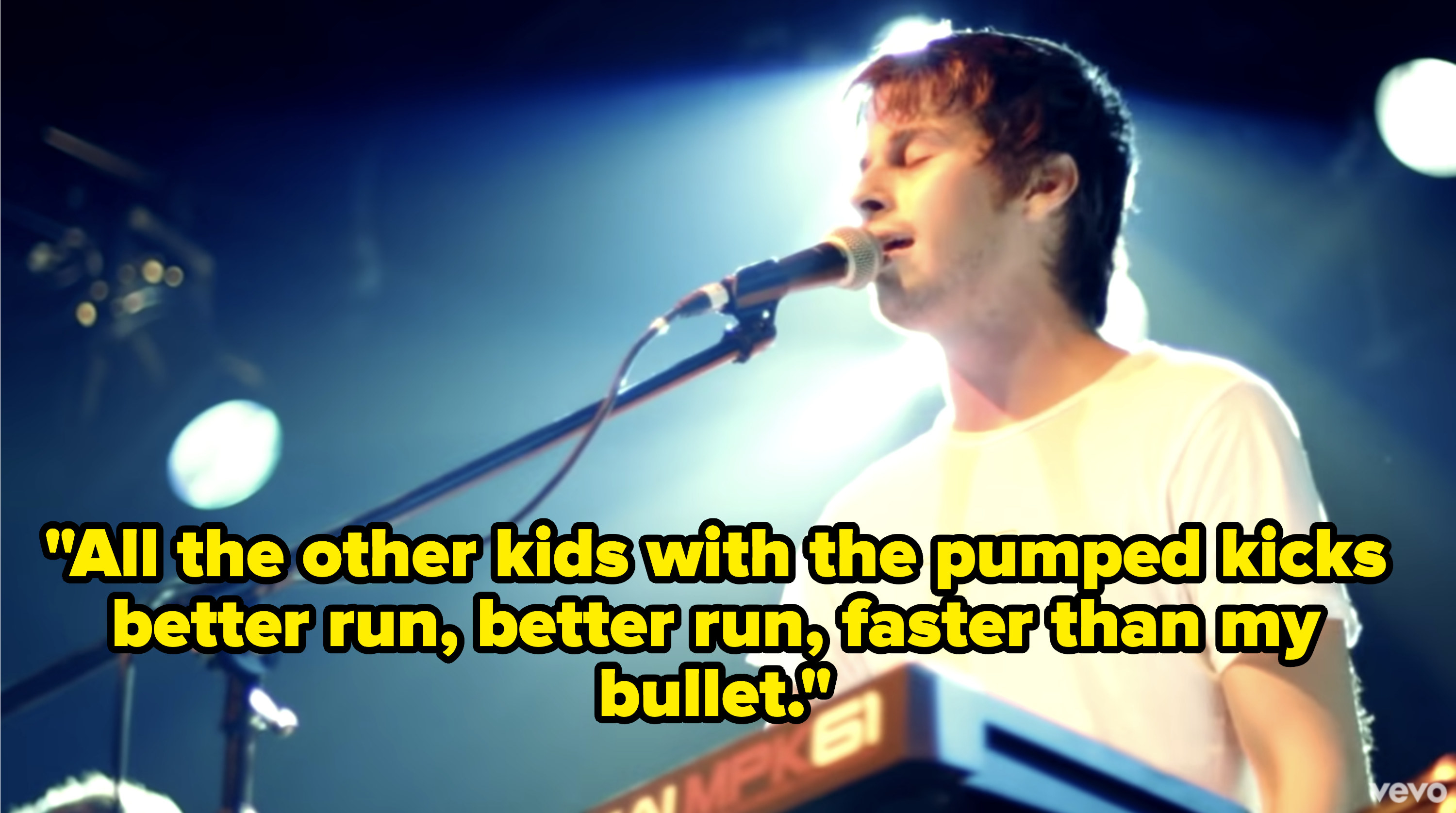 Frontman Mark Foster performing onstage at a concert.