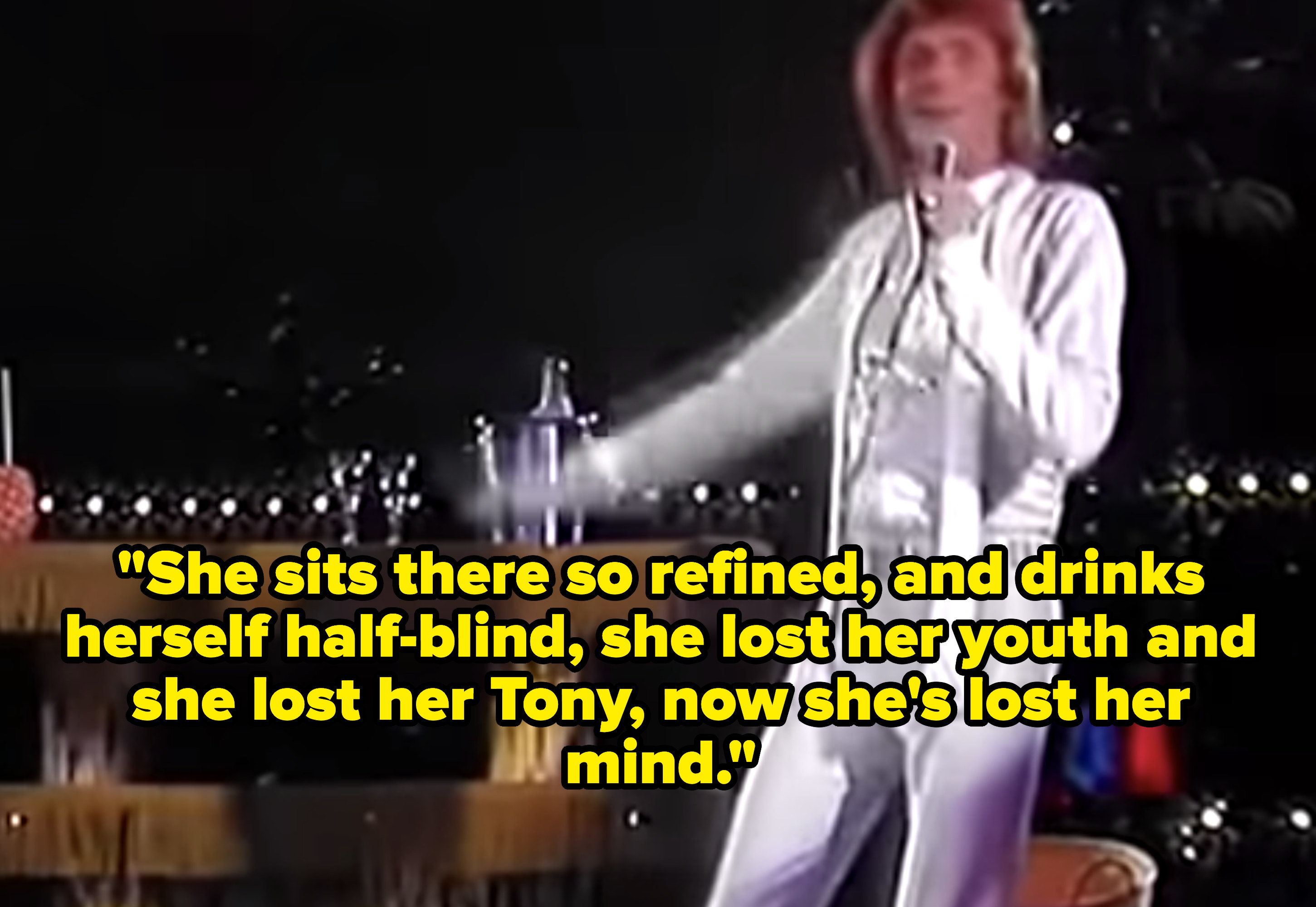 Barry Manilow singing in a bright, white suit.