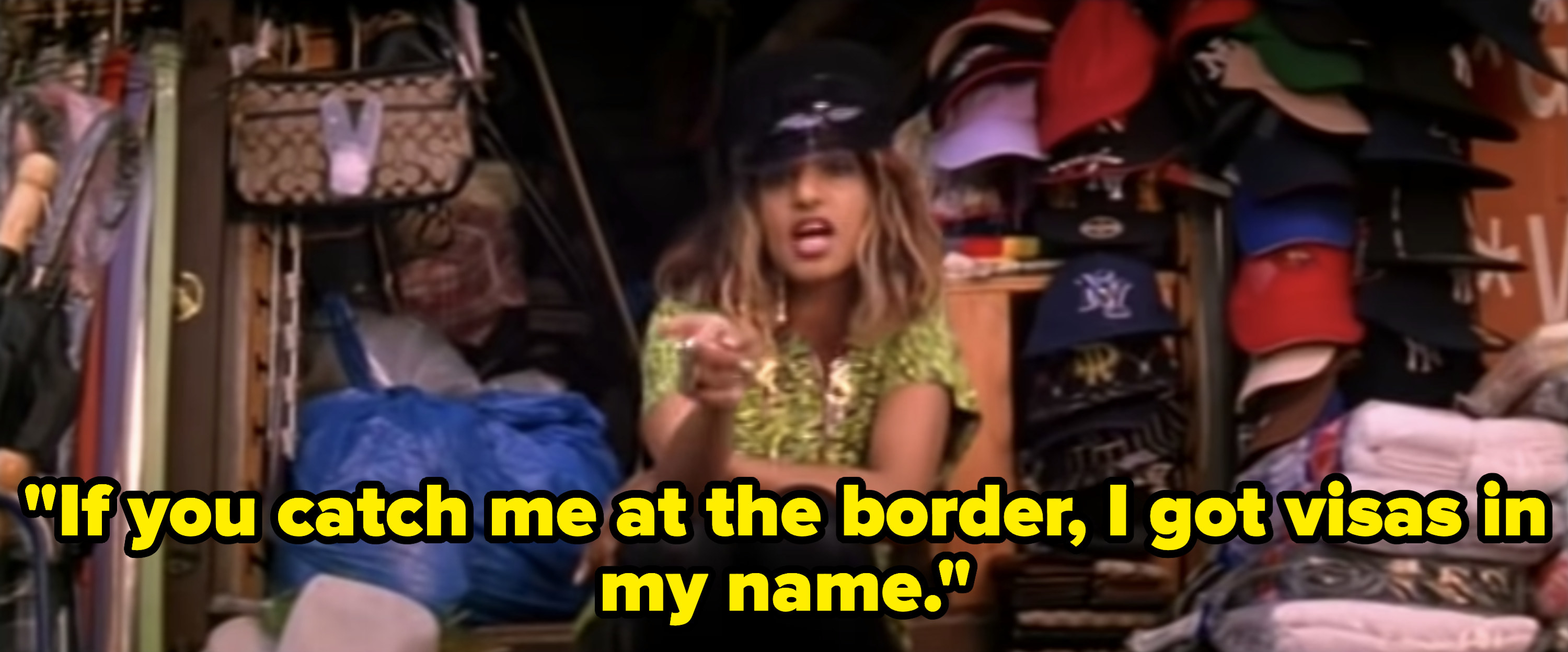 M.I.A. rapping in a hat shop.