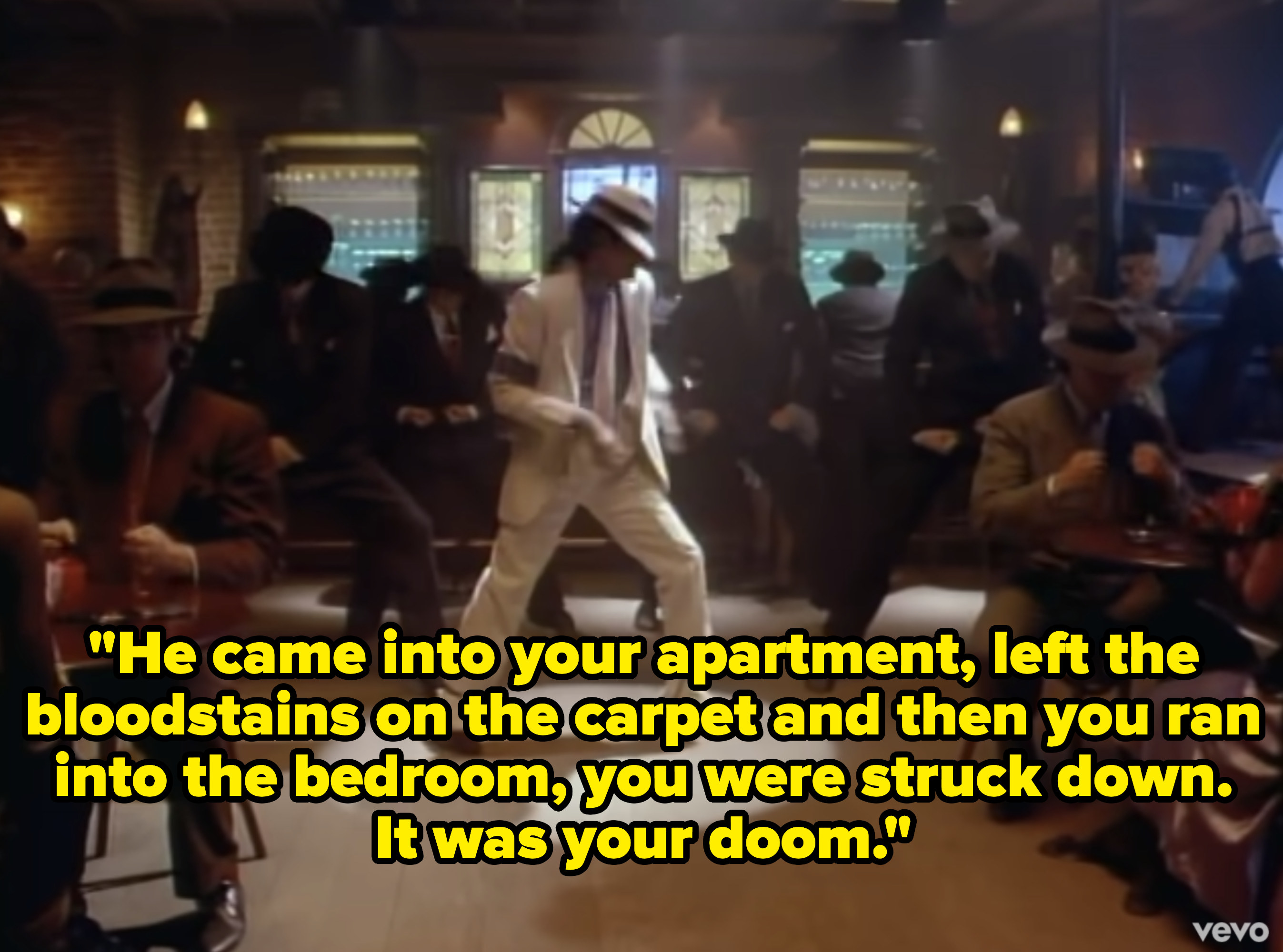 Michael Jackson in a white suit dancing in the middle of a saloon.
