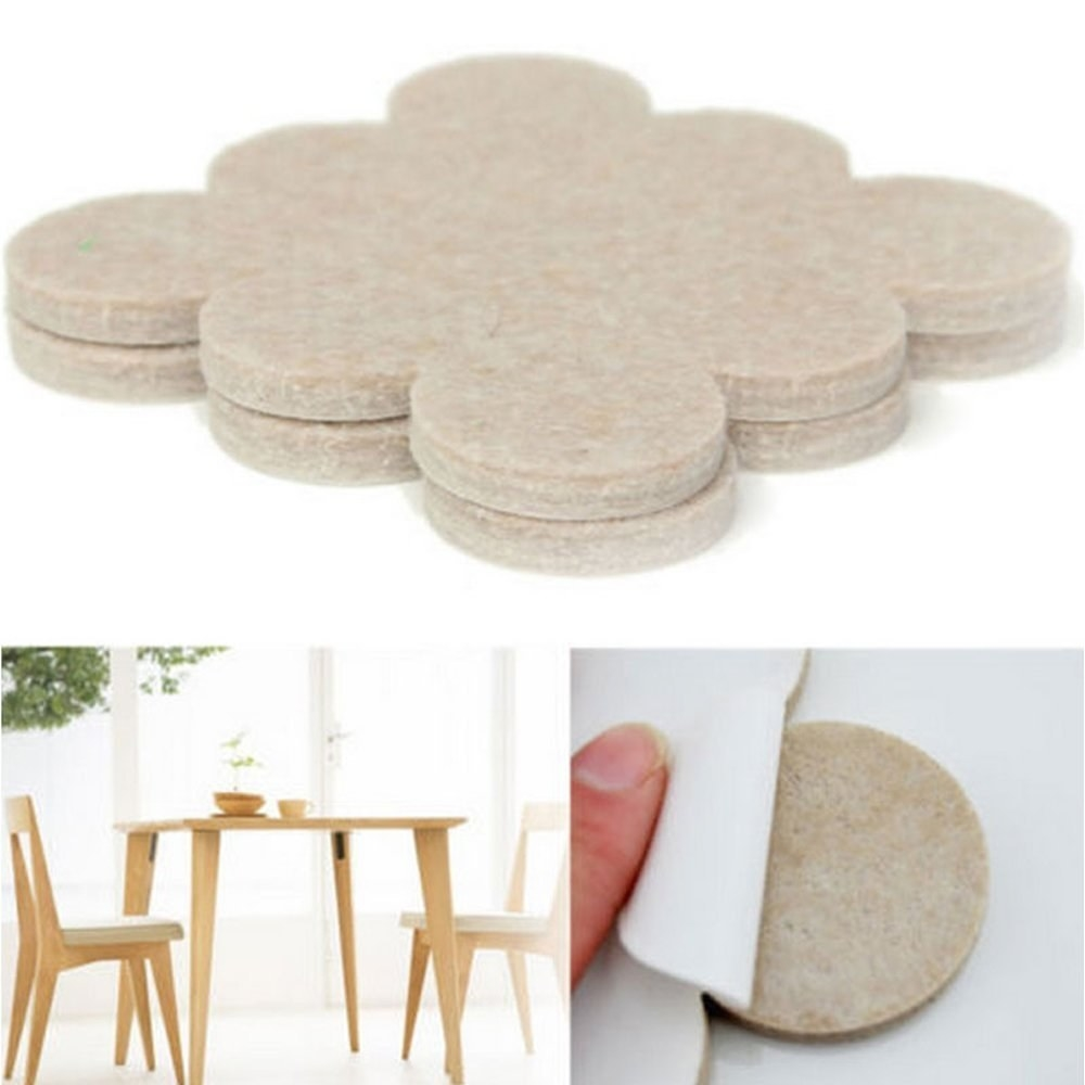 A set of adhesive felt pads applied to chairs
