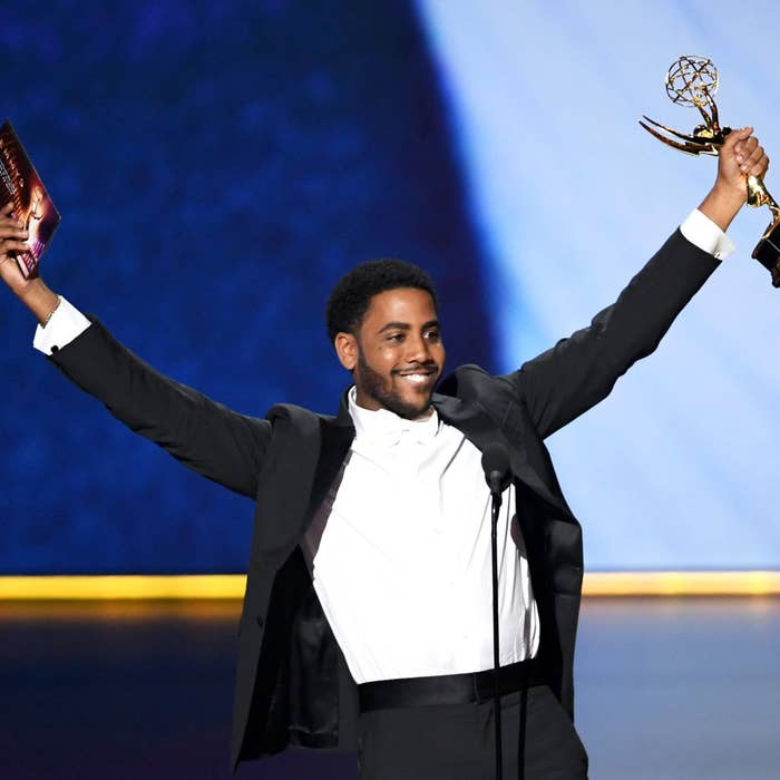 Jharrel holding his Emmy on stage