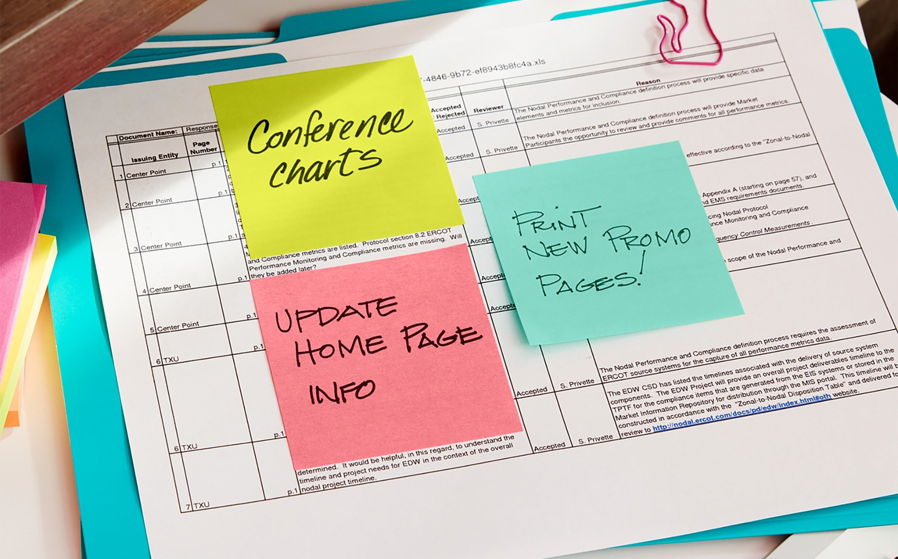 The Post-Its in green, pink, and light blue marking a planner