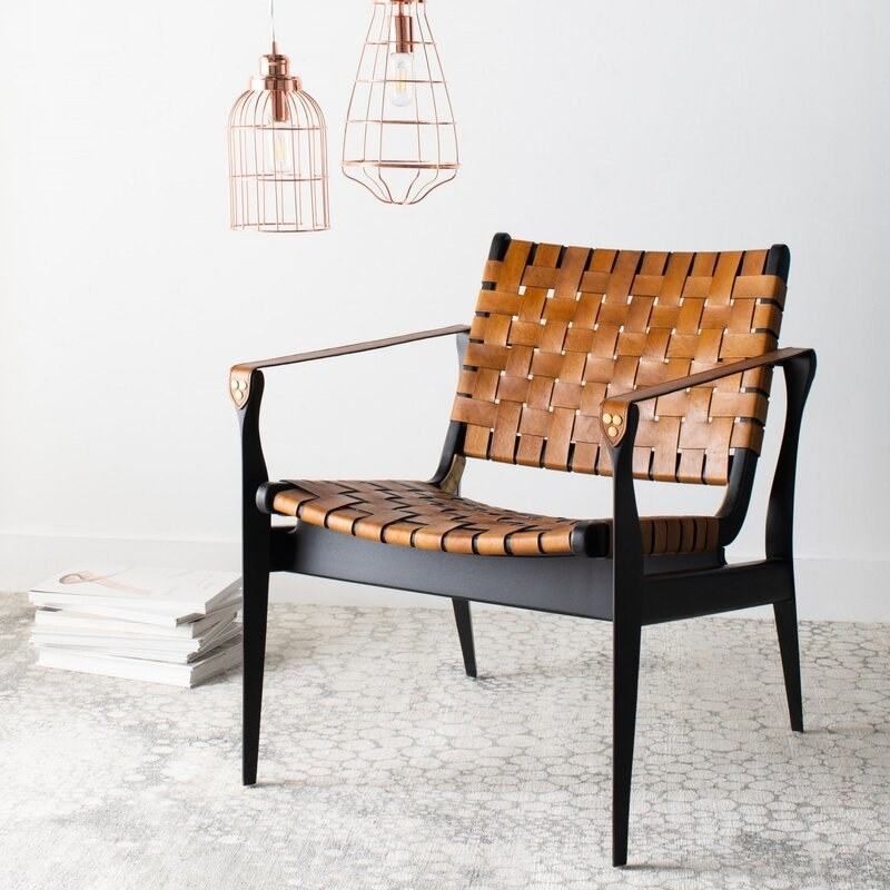 The black chair with tan woven back and seat