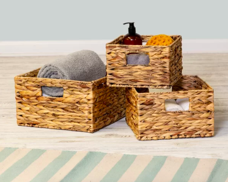 Three rectangular wicker baskets with cut out handles in varying sizes