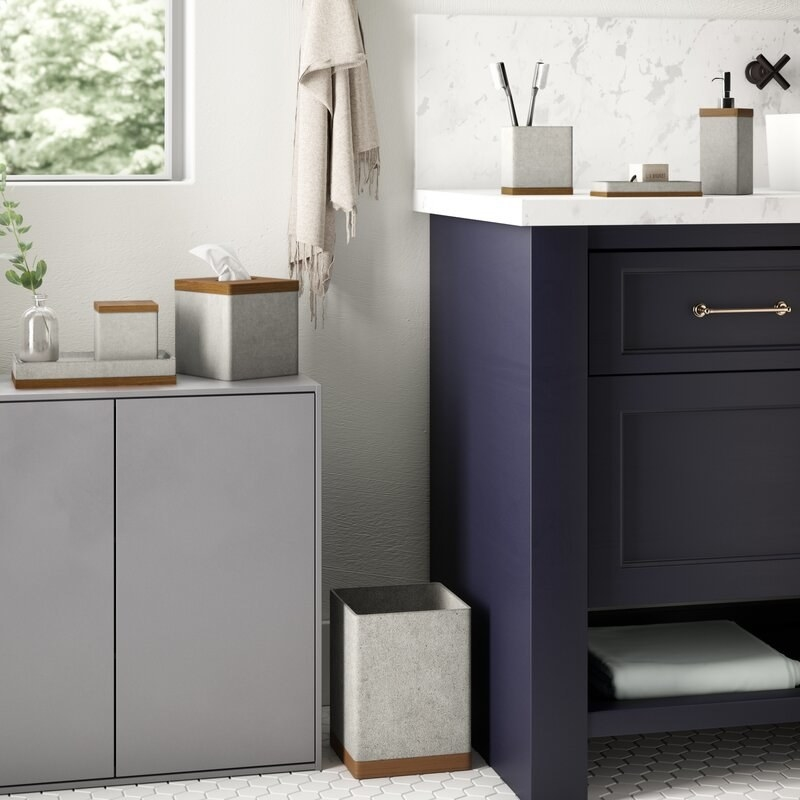 The cement set with a wooden base detailing styled in a modern bathroom