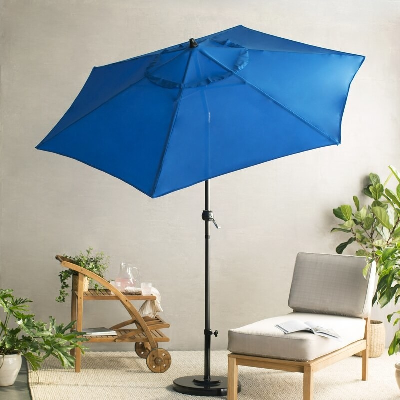 Blue umbrella shading an outdoor chair