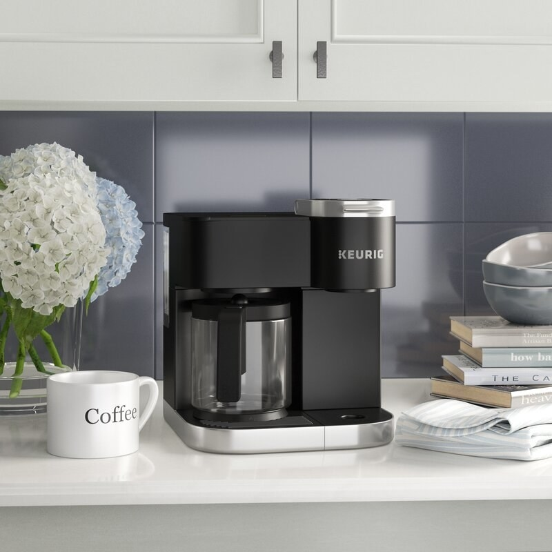 Black keurig machine with carafe on a counter