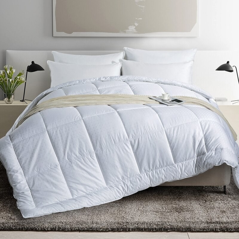 Wayfair's all season comforter styled on a bed