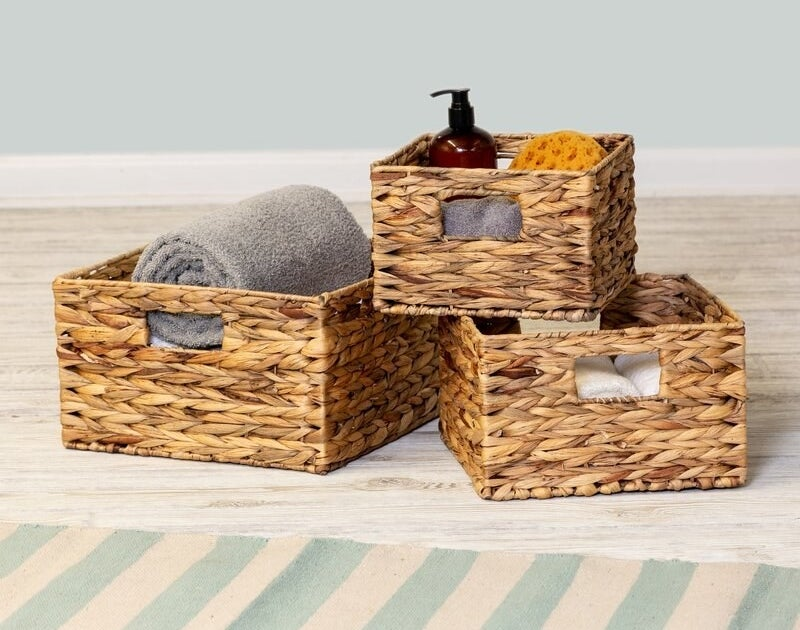 Three rattan baskets with holes for handles