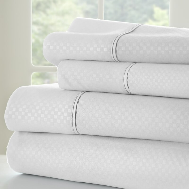 The folded sheets with a satin and matte checkered pattern