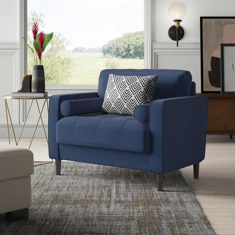 Boxy wide navy blue sofa chair
