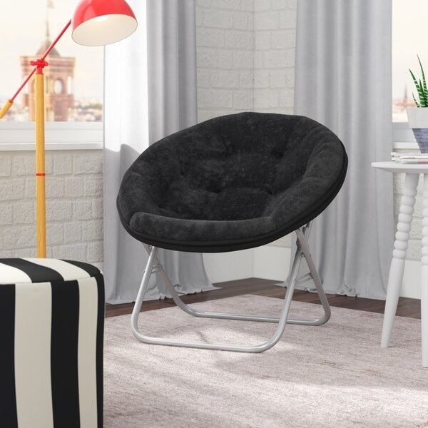 Black round chair with foldable pipe legs