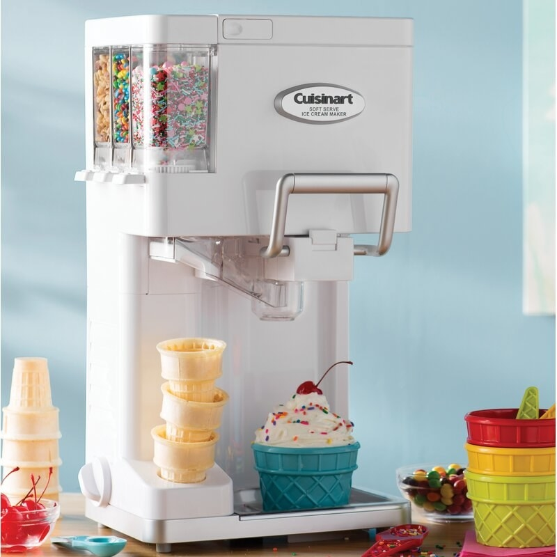 the ice cream maker with three attached compartments for sprinkles