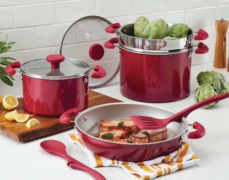 a red set of pots and pans