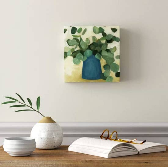 Abstract canvas art of leaf-filled pot