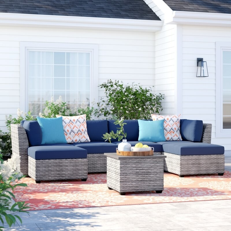 Wicker sectional furniture with gray bottom and navy blue cushions