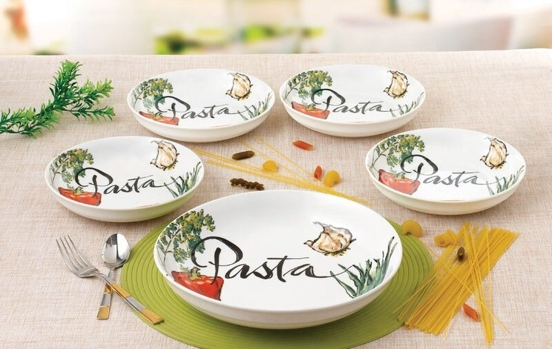 pasta bowls with the word pasta written inside and illustrations of tomatoes, garlic, and herbs