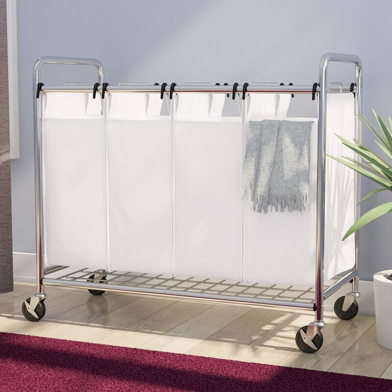 Metal hamper with four hanging bags to separate laundry