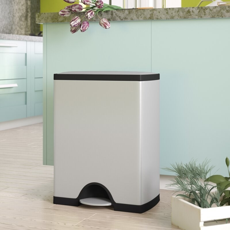 The light gray rectangular trash can with black accents