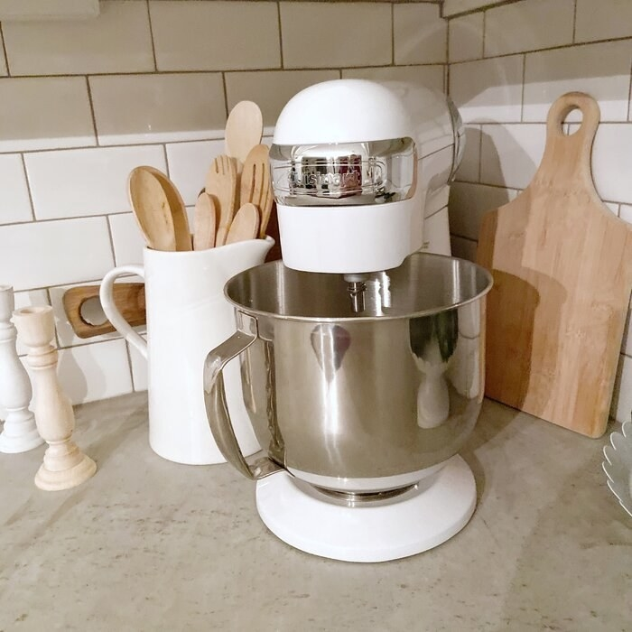a reviewer's white stand mixer on a counter top