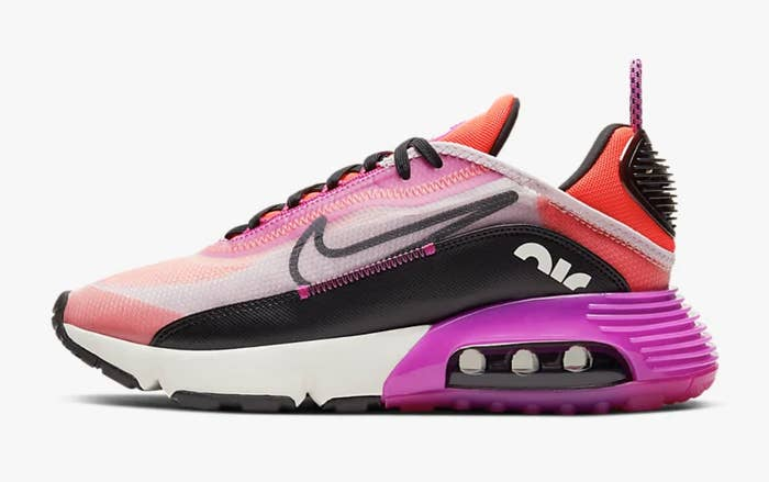 The sneakers in pink and purple with black details and a transparent mesh