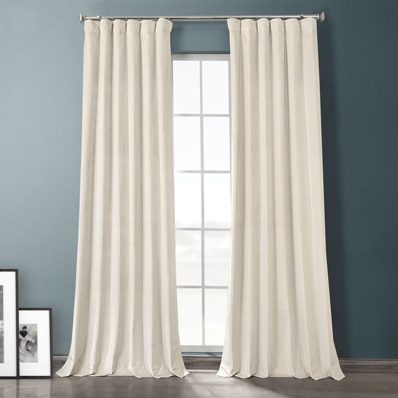 white velvet blackout curtains on a window