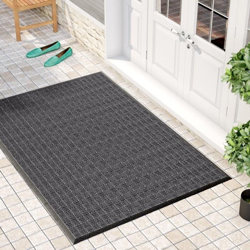 Gray doormat at a door