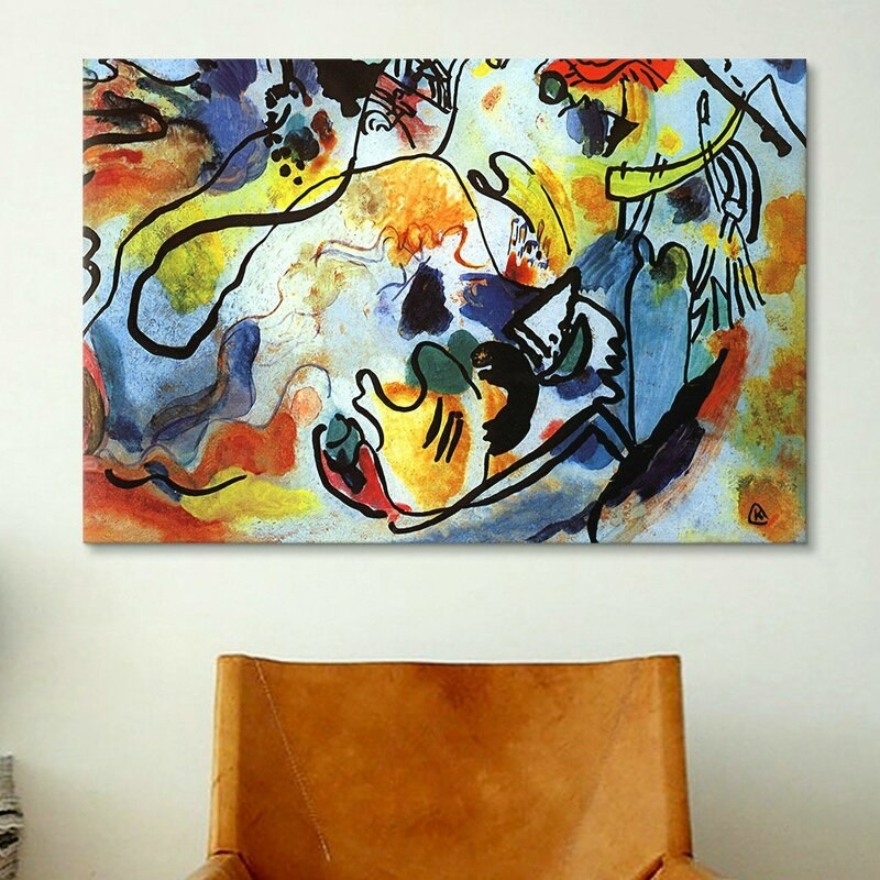 The canvas print on a wall with an abstract design  in blue, red, and yellow with black outlines.