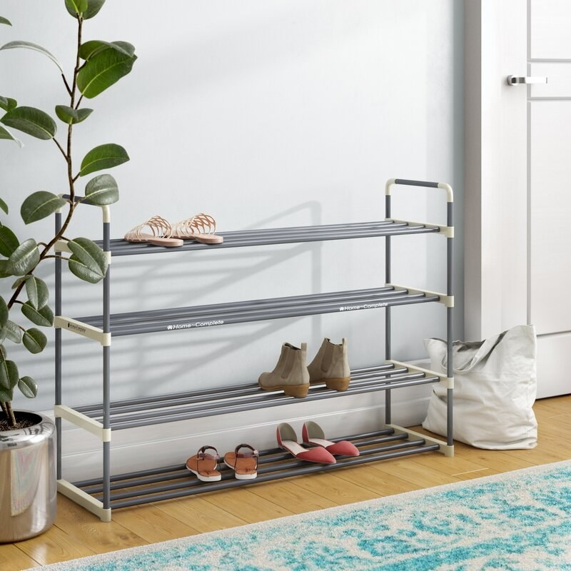 The grey and white rack with shoes