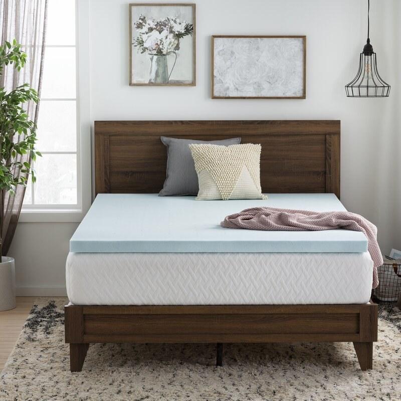 Brookside's memory foam topper styled on a mattress