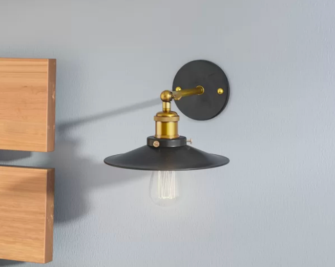Black and gold light with exposed bulb