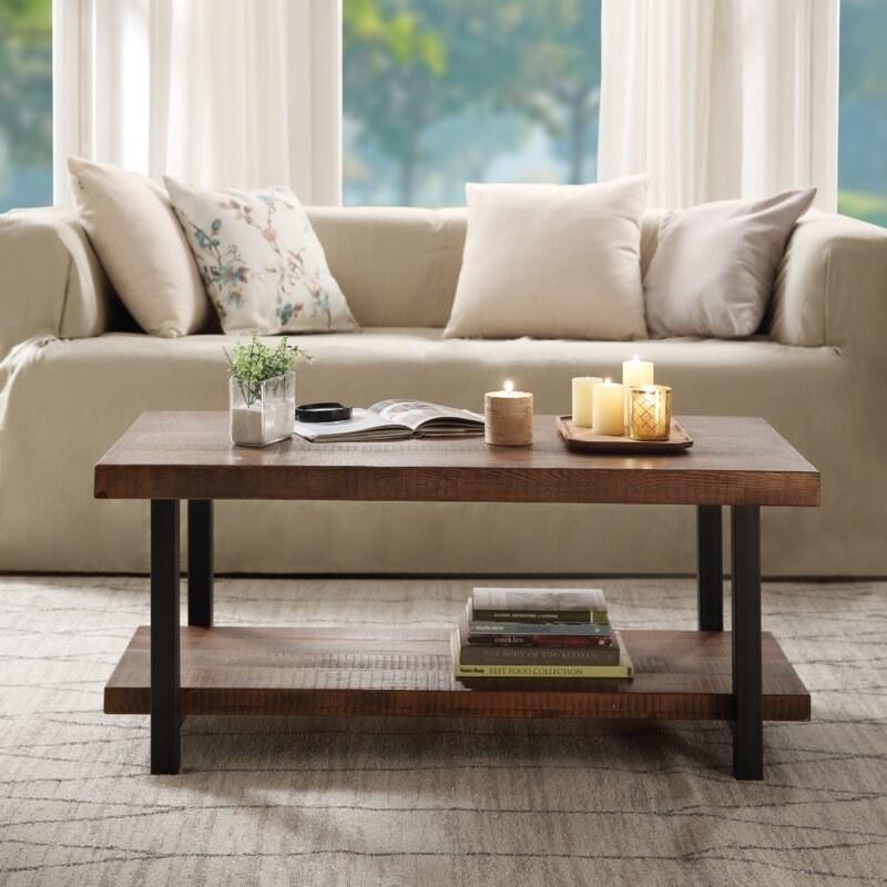 The dark wood rectangular coffee table