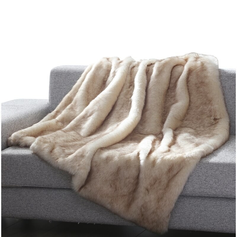 The cream and brown toned blanket