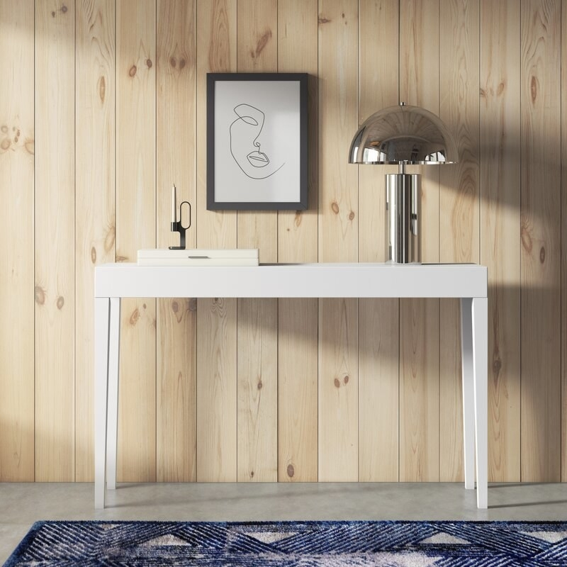 The white thin console table
