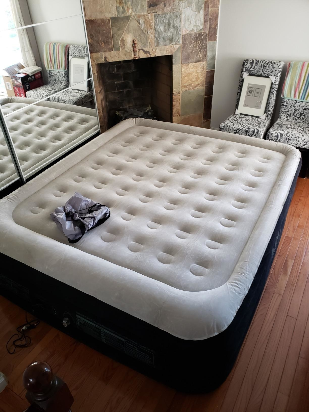 A reviewer showing the mattress in their room