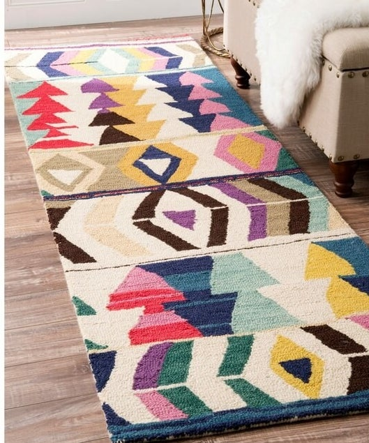 The rectangle-shaped rug with boho-like multicolor geometric pattern throughout.