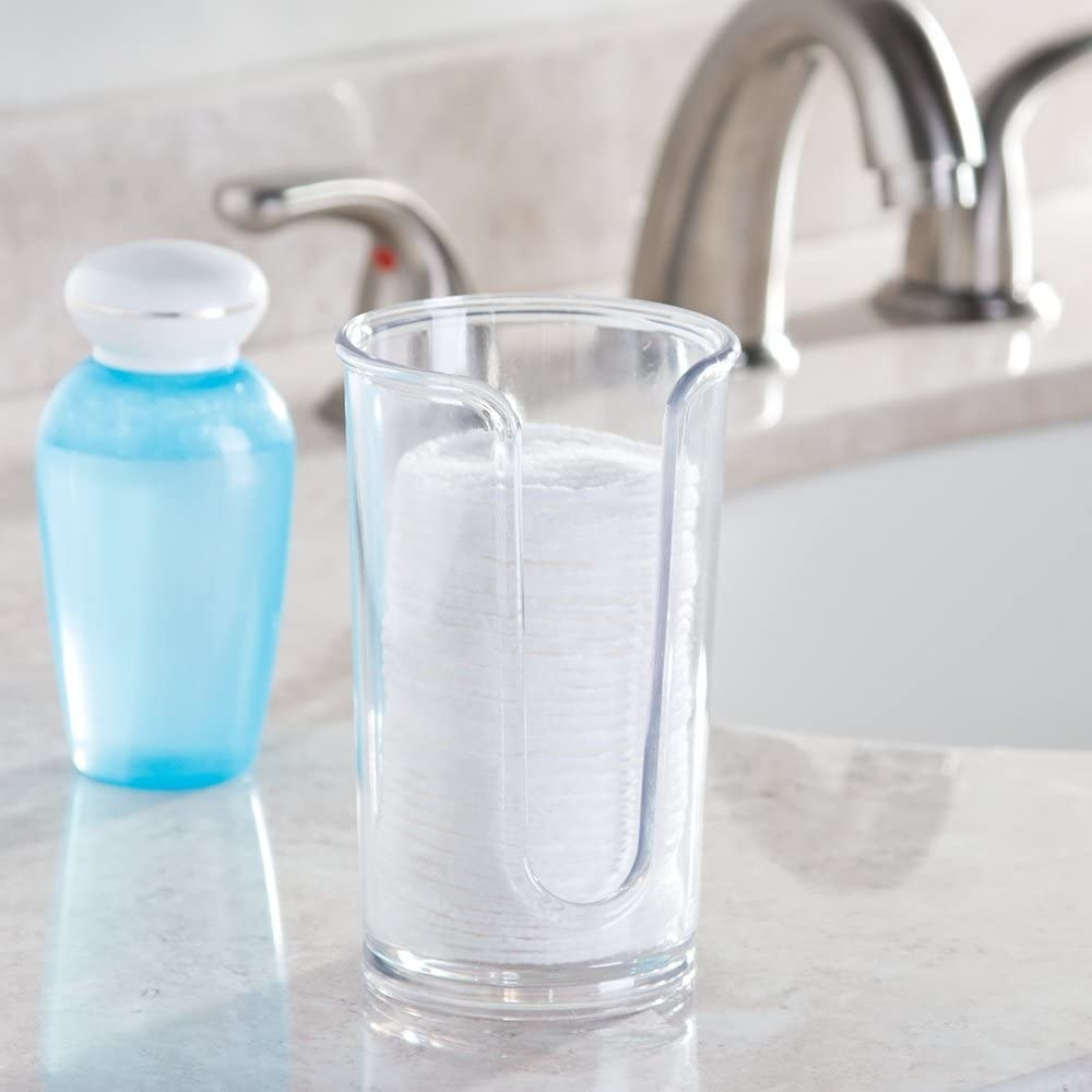 The acrylic cotton pad holder next to a sink