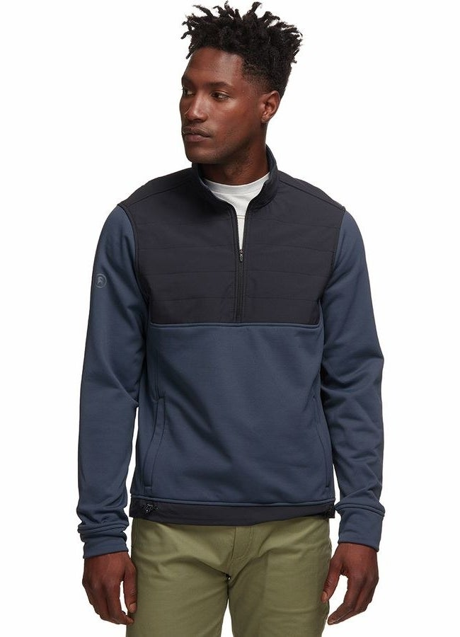model in navy blue jacket with pockets that's a darker blue on the chest panel