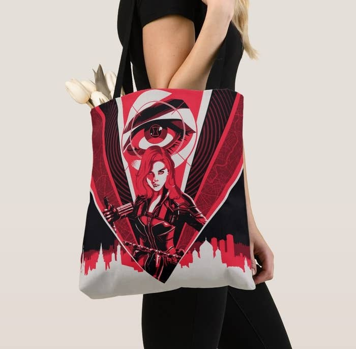 A black, white, and red all over image of Black Widow on a tote bag
