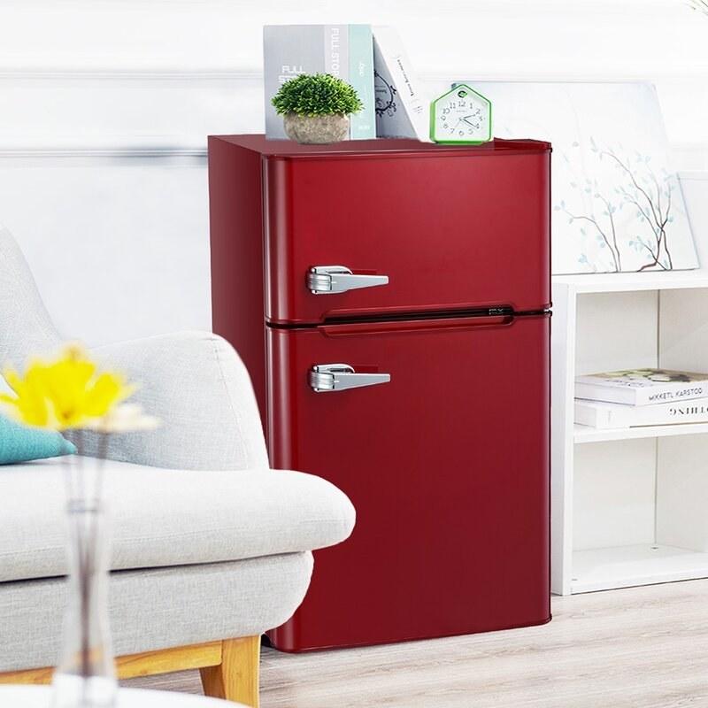 a red retro styled mini fridge and freezer