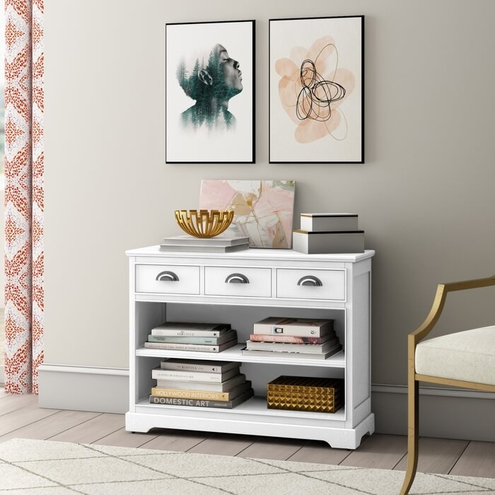 The Seashell White Witherell Standard Bookcase in a decorated living room