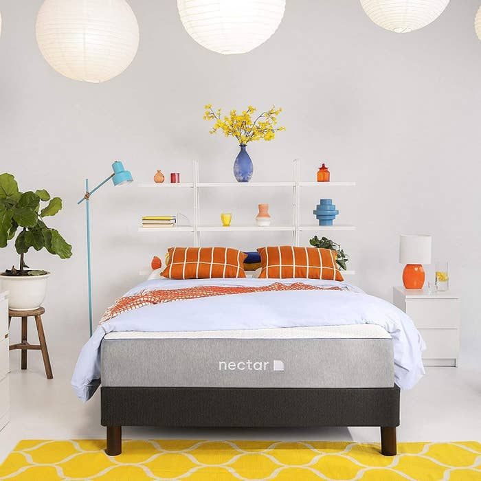 Product photo showing the Nectar mattress styled in a bed room