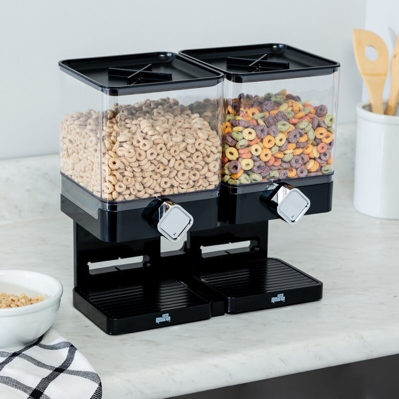 The black dispensers with two containers, and spinning knobs you turn to dispense